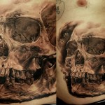 Ancient Skull realistic tattoo on belly