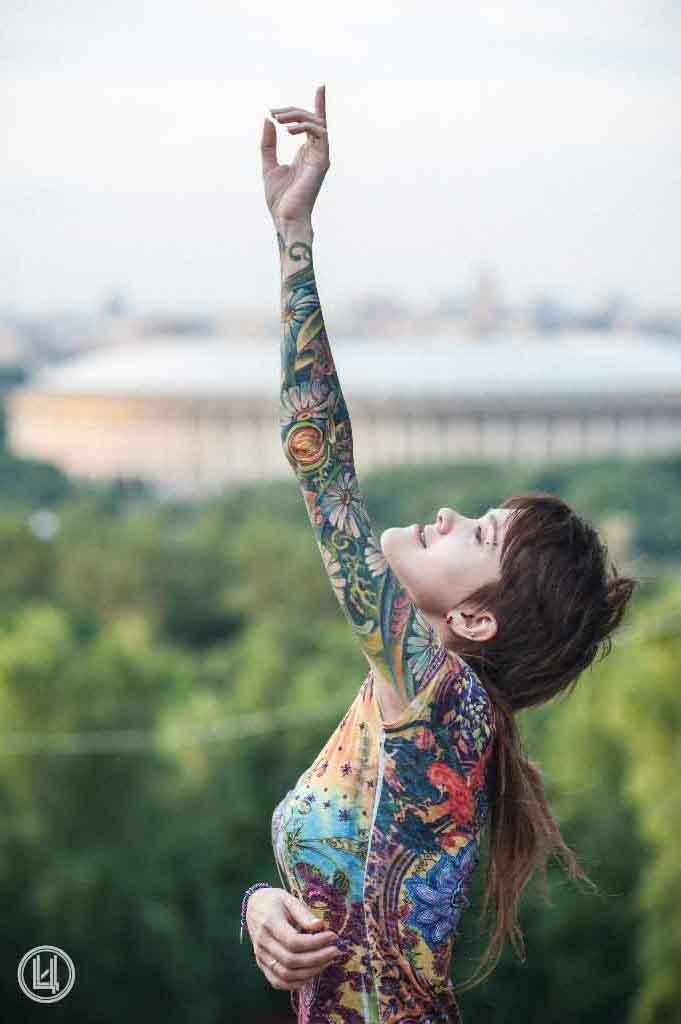 Flower Hand tattoo to sky