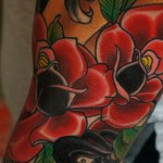 Red Roses traditional tattoo on sleeve