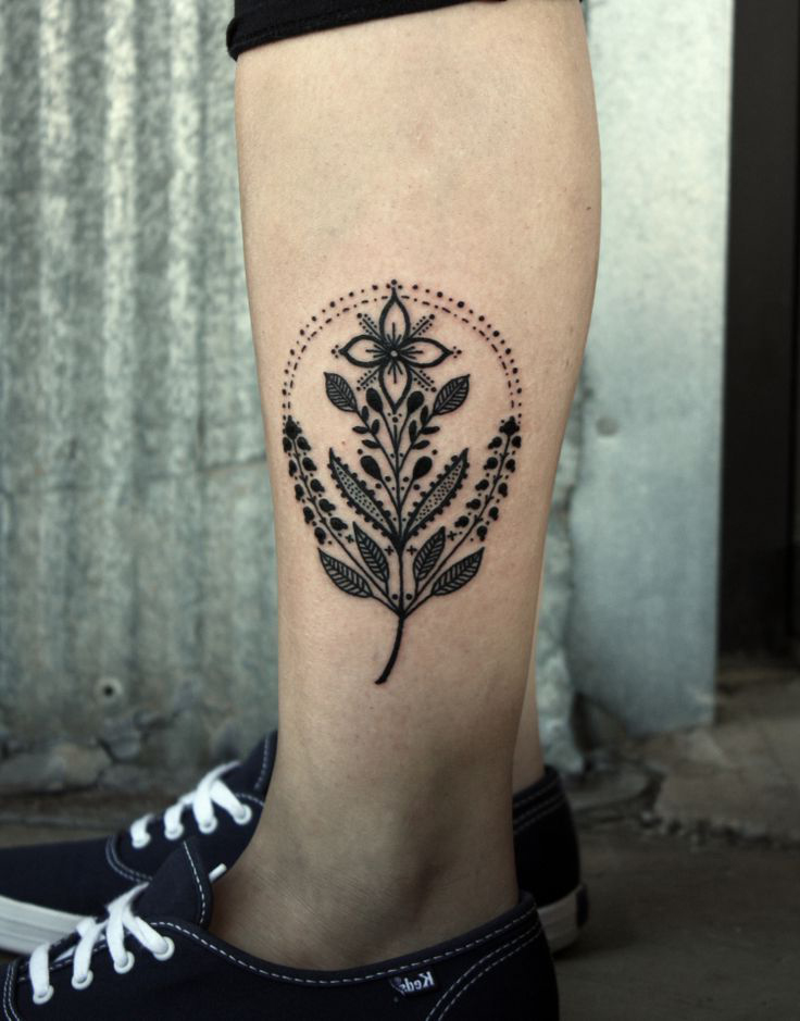 Dotwork Symbolic Flower tattoo on leg