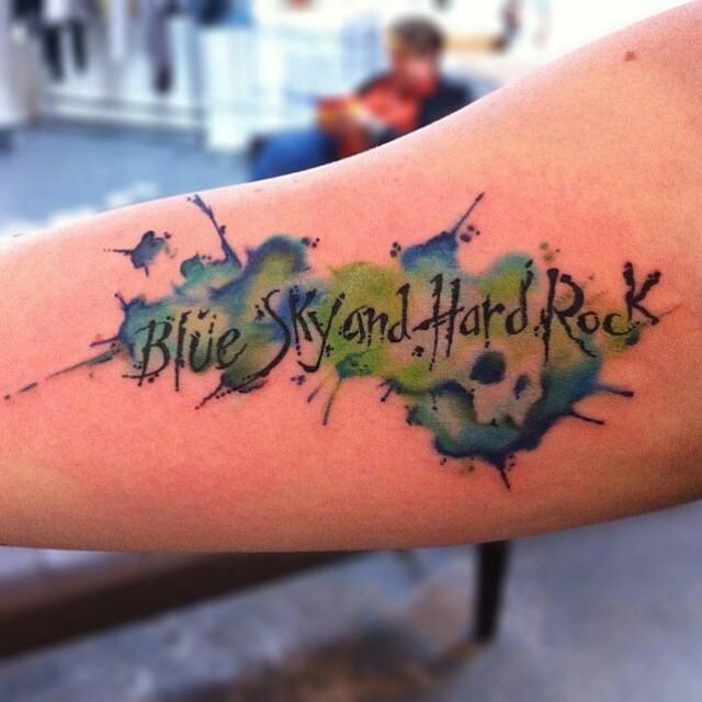 Aquarelle Blue Sky and Hard Rock Lettering tattoo by Jason Middelton