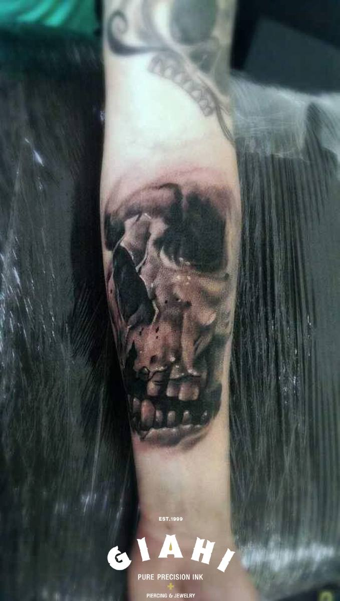 Arm Graphic Toothless Skull tattoo by Goran Petrovic