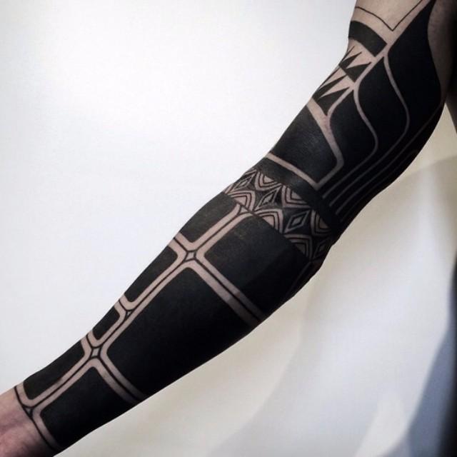 Blackwork tattoo sleeve by Nissaco Tatau
