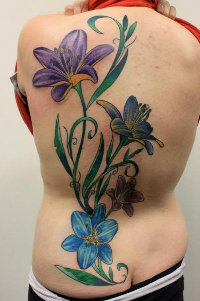 Blue and Violet Flower tattoo on Back by Tantrix Body Art