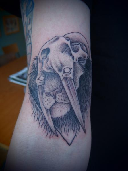 Fang Scull Lion Dotwork tattoo by Papanatos Tattoos