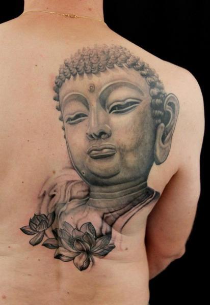 Flowers and Buddha tattoo on Blade by Skin Deep Art