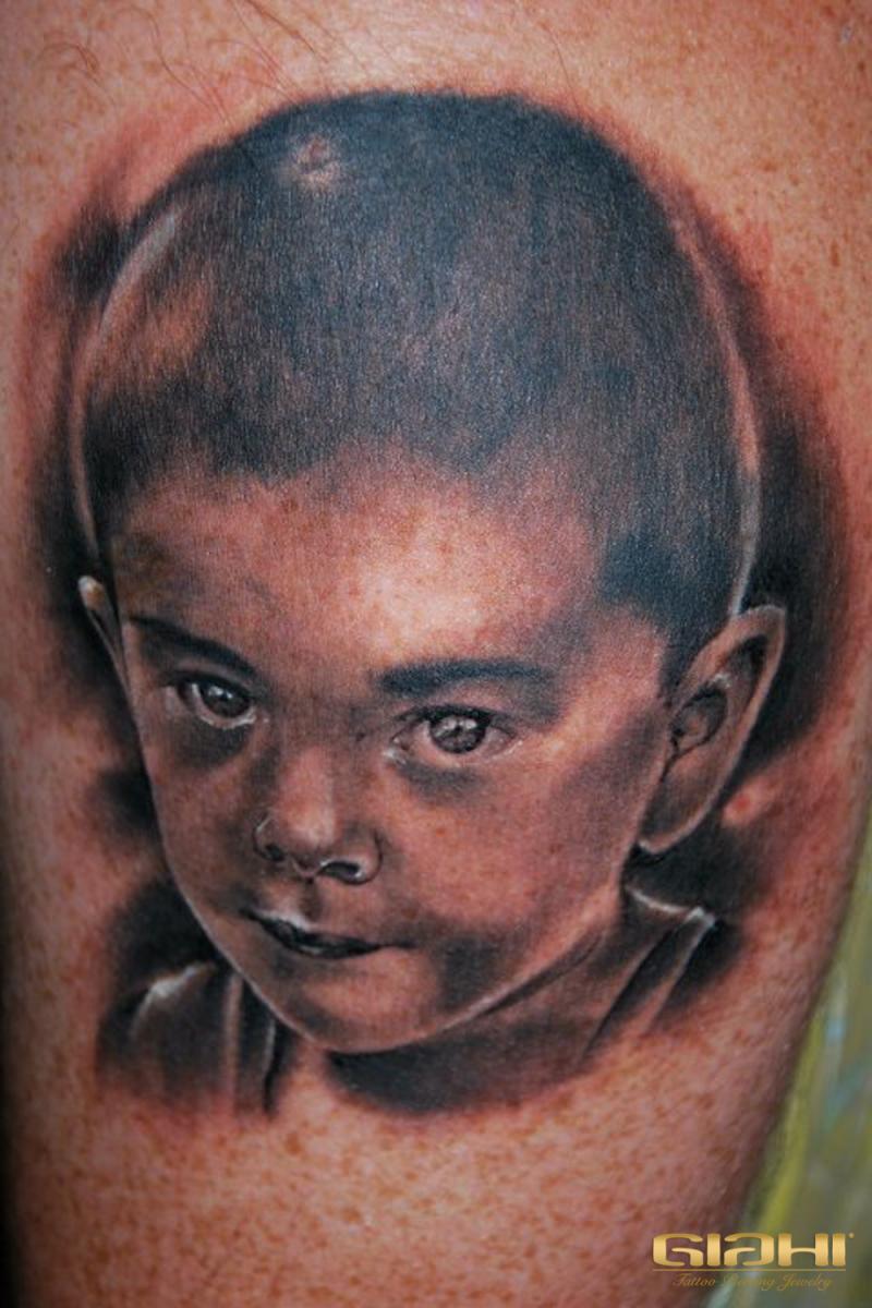 Graphic Realistic Kid Portrait tattoo by Szilard