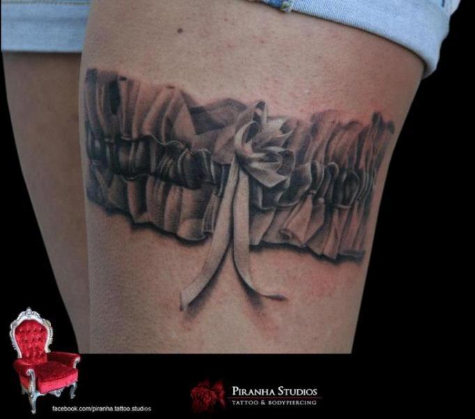Graphic garter tattoo by Piranha Tattoo Supplies