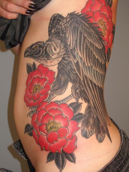 Red Flowers Vulture tattoo by Three Kings Tattoo