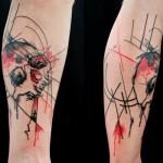 Red and Black Skull Trash Polka tattoo by Skin Deep Art