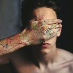 Map and cat tattoo