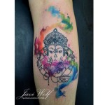 Beautiful Watercolor Ganesha Leg tattoo by Javi Wolf