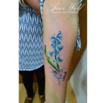 Bellflower Watercolor Arm tattoo by Javi Wolf