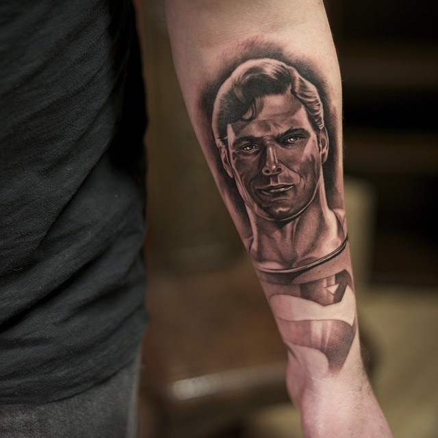 Graphic Arm Superman tattoo by Charles Saucier