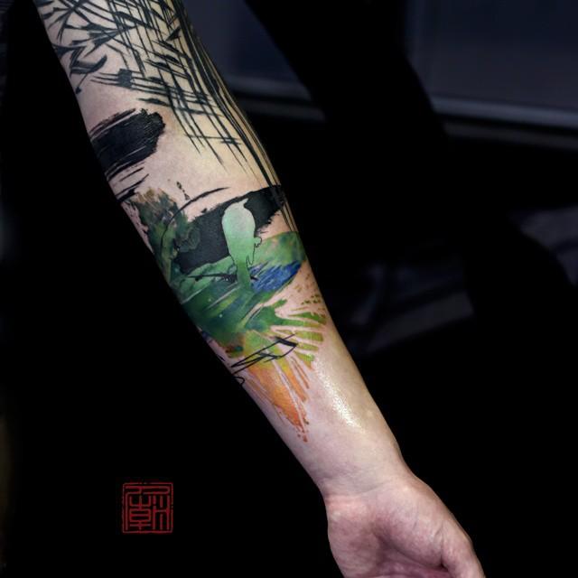 Great Aquarelle tattoo sleeve by Tattoo Temple