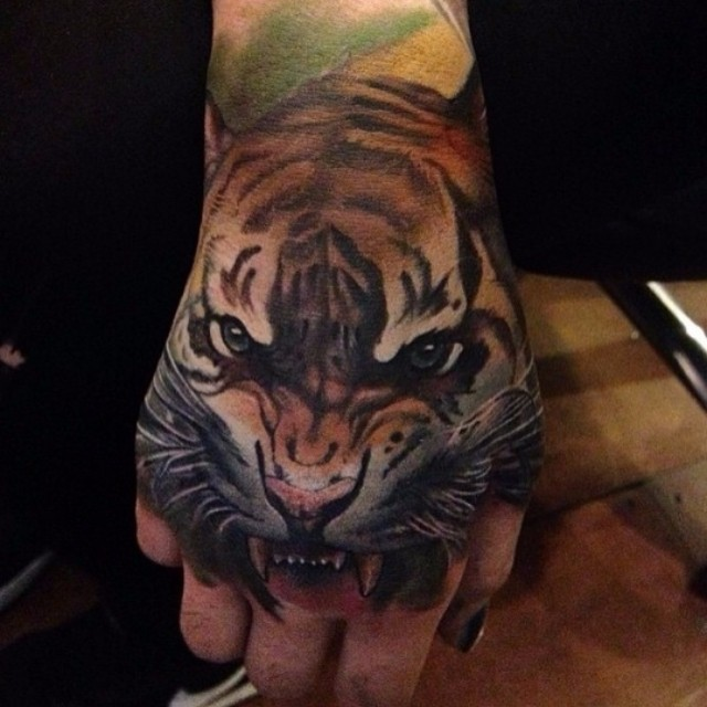 Tiger Face Hand tattoo