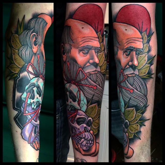 Darwin with Skulls Arm tattoo