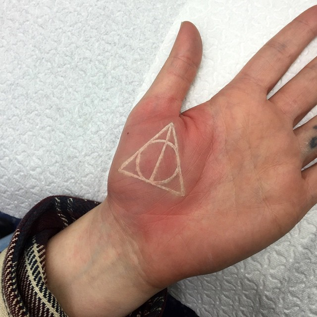 Circle in Triangle Palm tattoo
