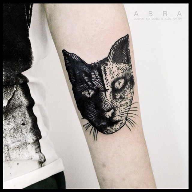Crosses in Eyes Cat Arm tattoo
