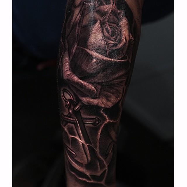Dark Graphic Rose and Anchor tattoo