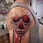 Grey and Red Skull on Shoulder