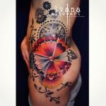 Mechanical Flower Hip tattoo