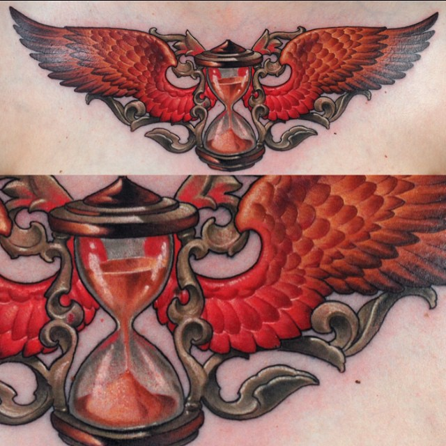 Orange Wings Hourglass tattoo