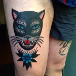 Thigh Flower and Cat tattoo