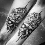 Matching Skull Tattoos on Arms