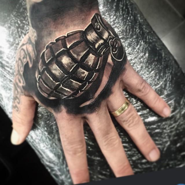 Black and Grey Hand Tattoo