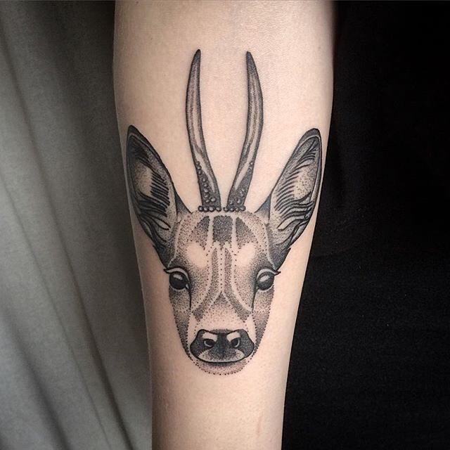very decent tattoo of a deer. tattoo on arm