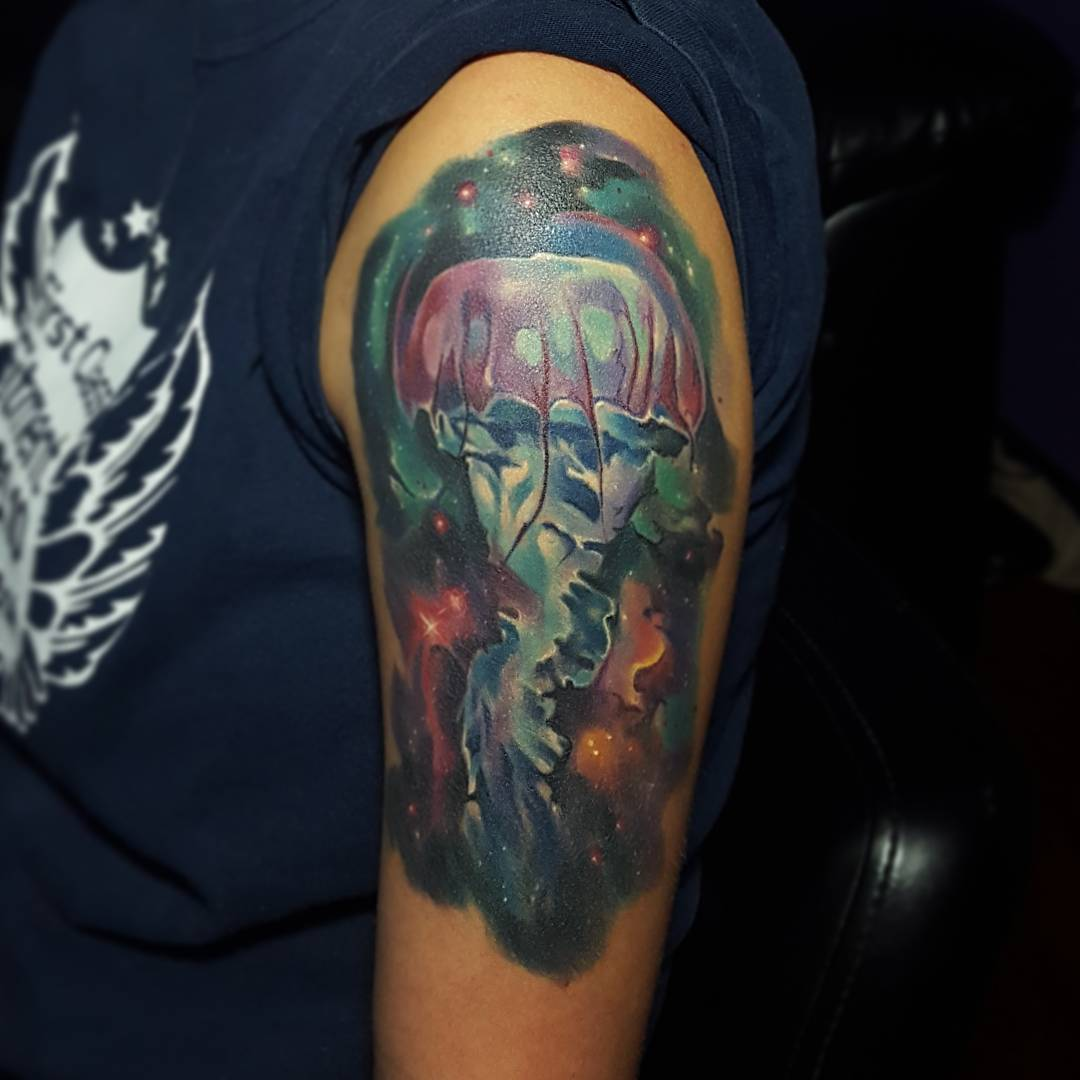 Jellyfish tattoo in space on shoulder