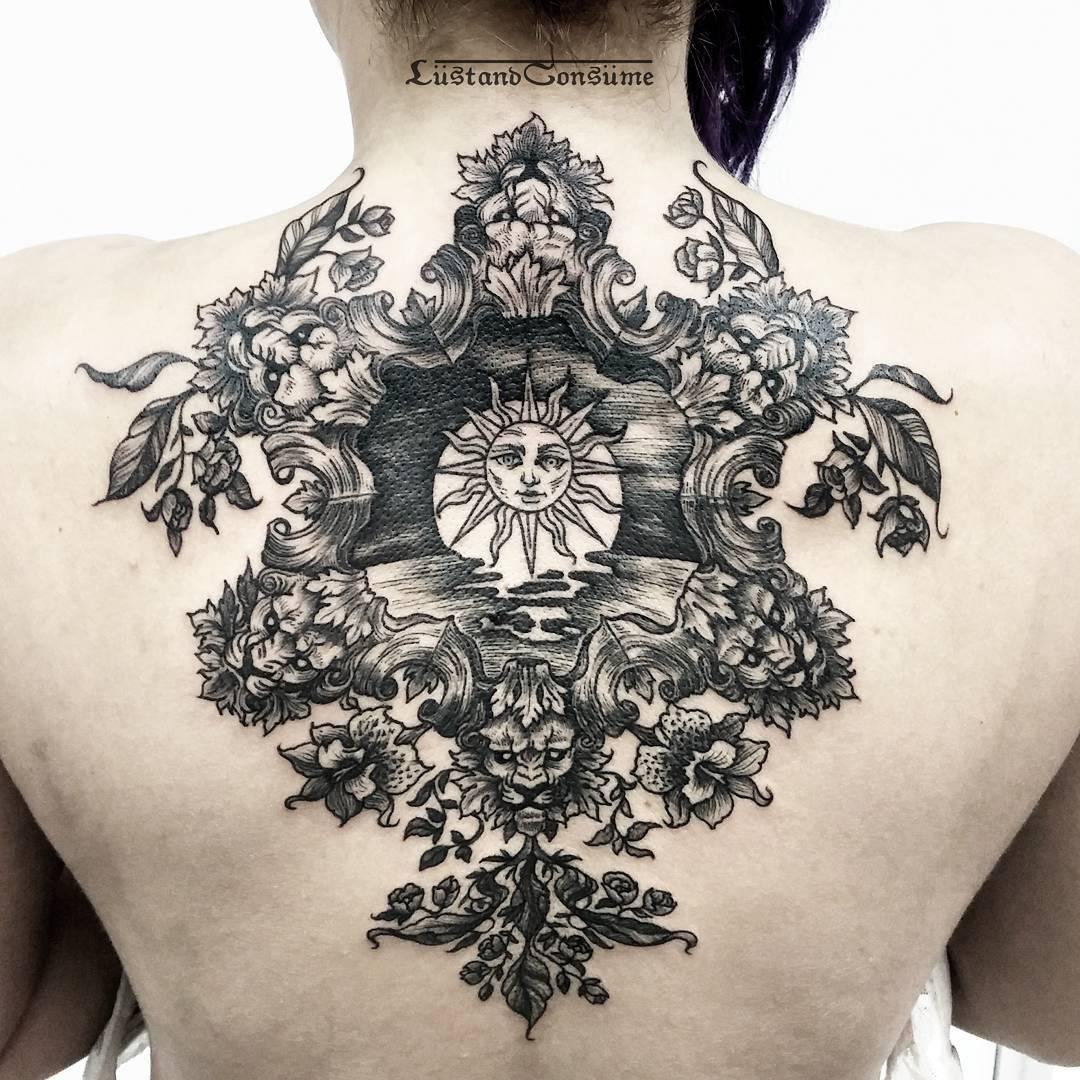 Sun Tattoo on Back