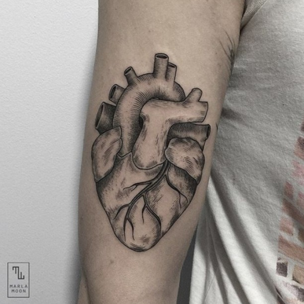 the anatomically correct etching heart tattoo on arm