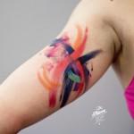 Bicep Brush Strokes Tattoo