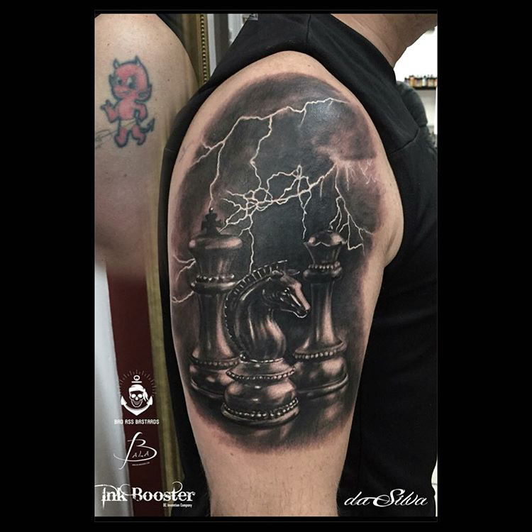 a shoulder tattoo of Chess Pieces