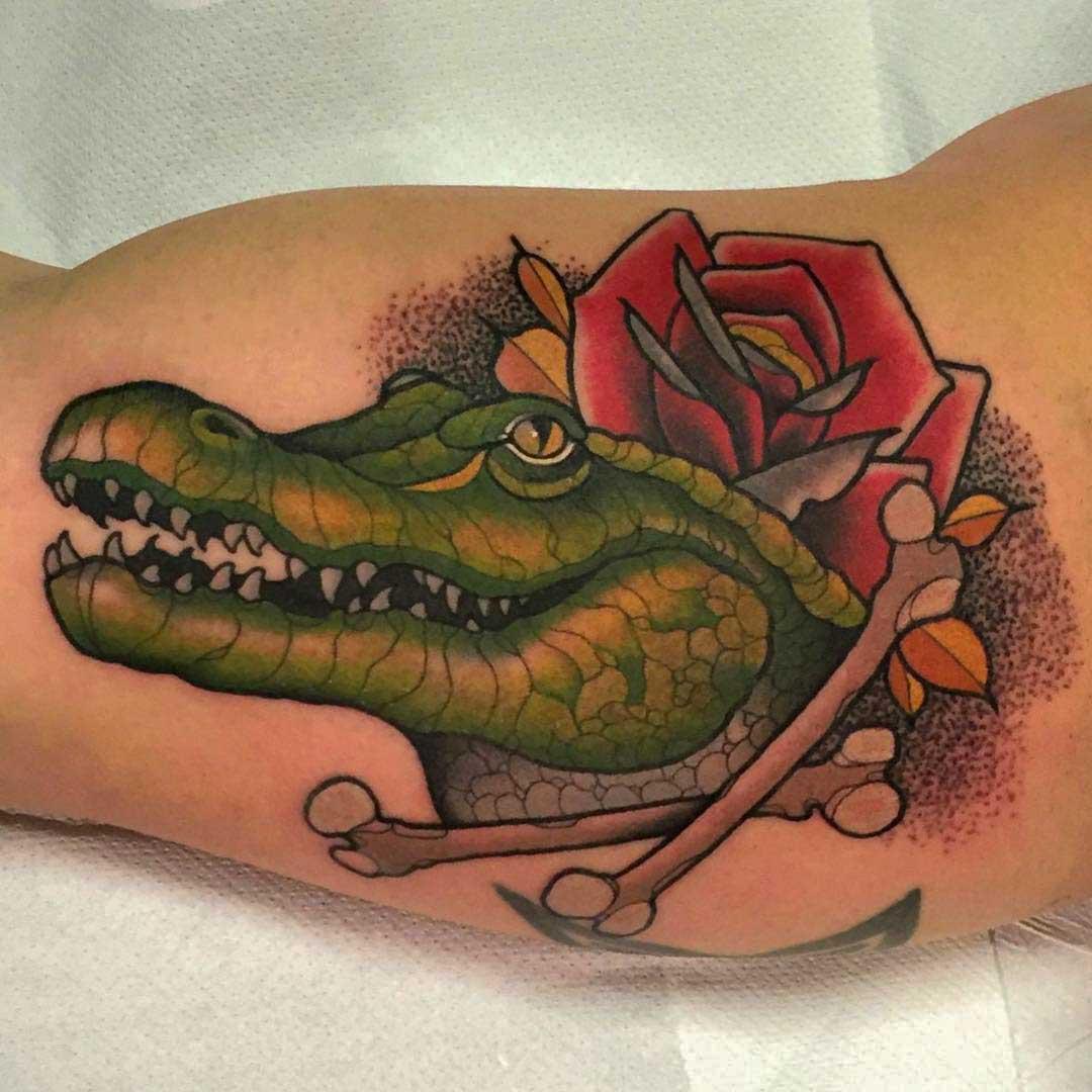 Crocodile tattoo on bicep