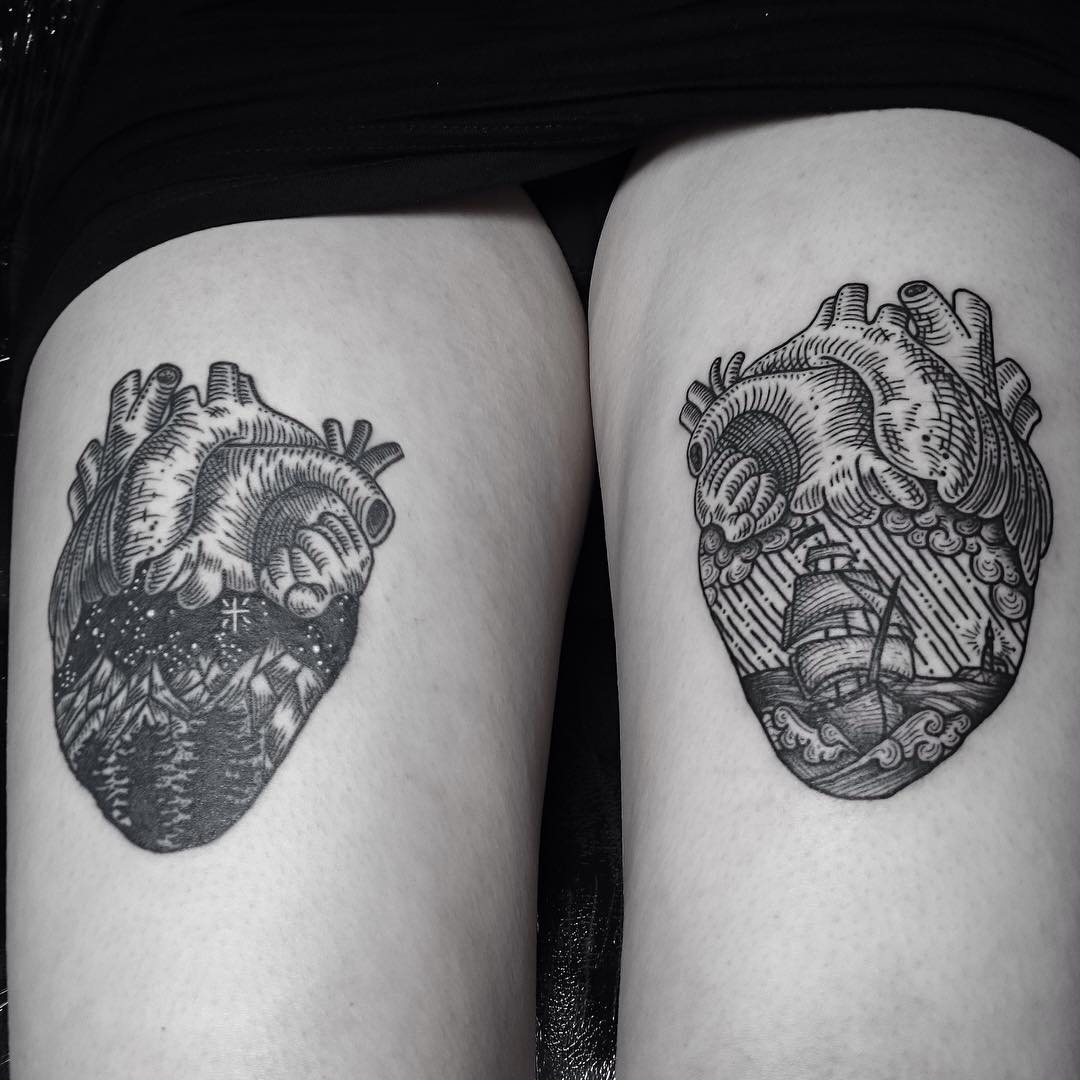 two heart tattoos on thighs