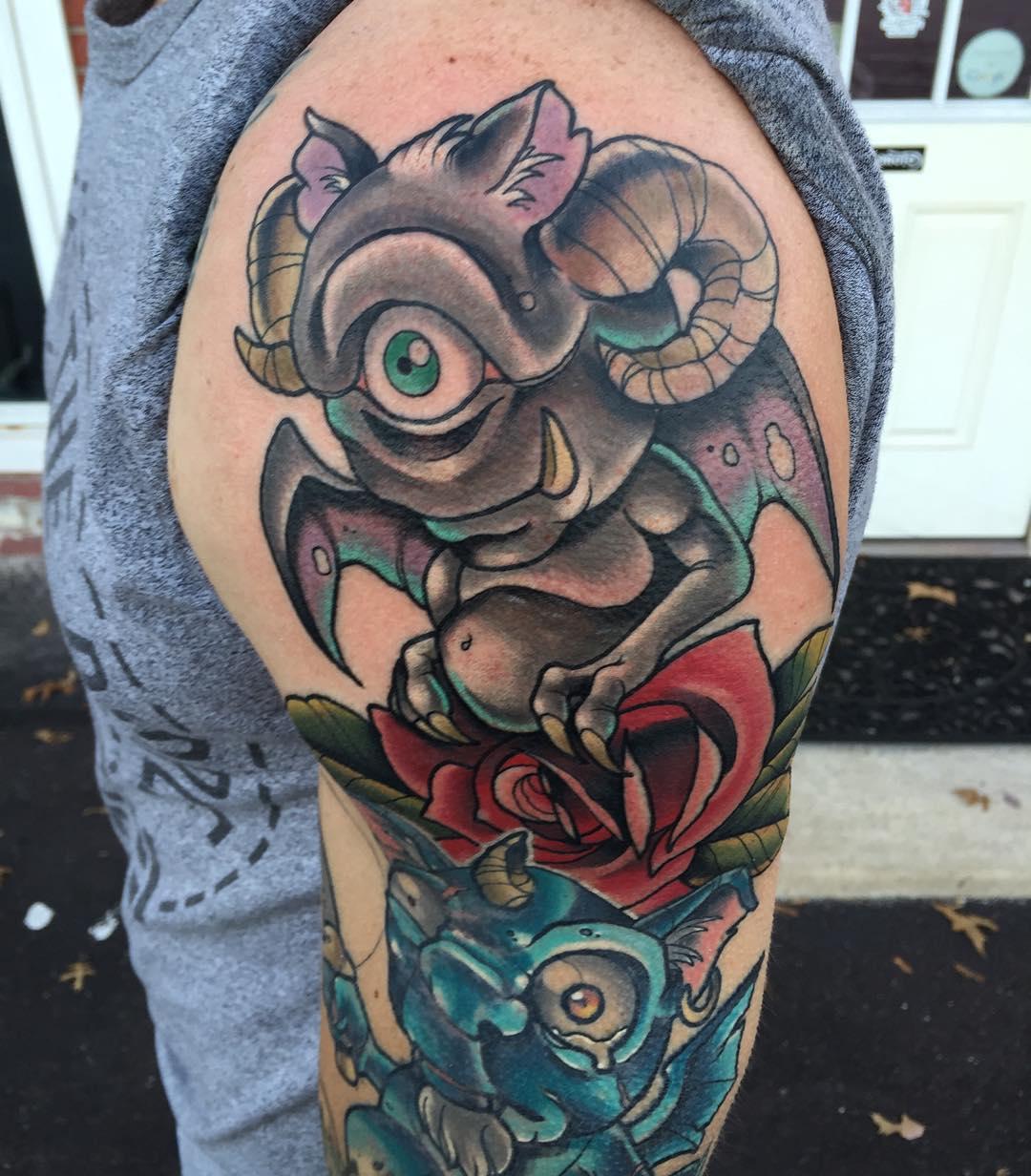 one-eyed new school imp tattoo on shoulder