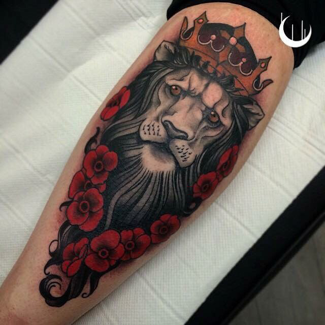 lion with crown tattoo on calf