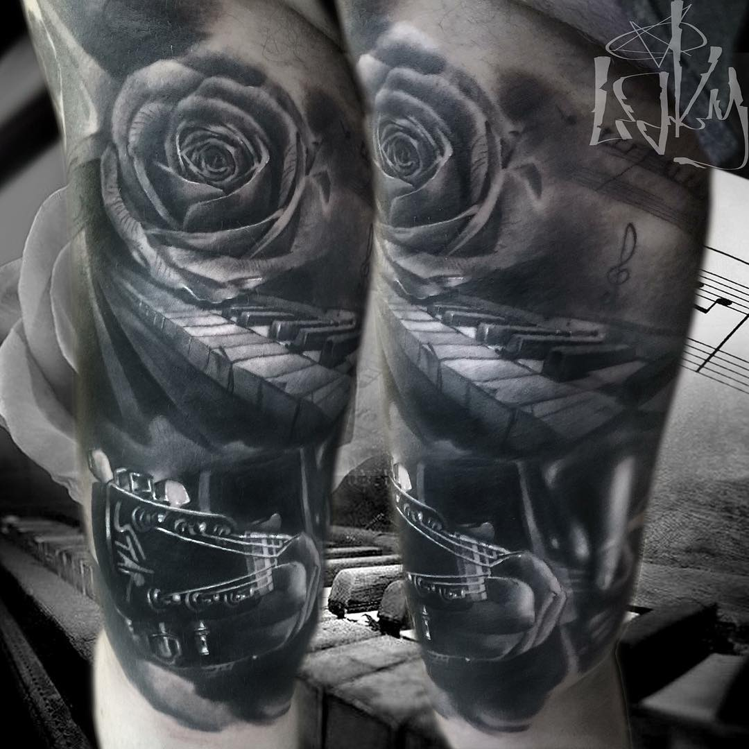 black and grey musical tattoo of musical instruments