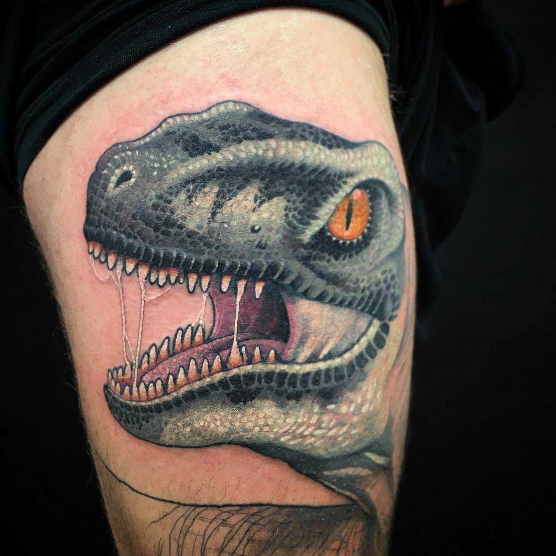 dinosaur raptor tattoo