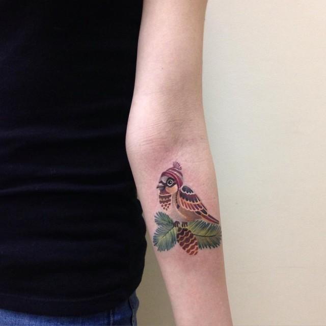 arm tattoo of a little bird sparrow