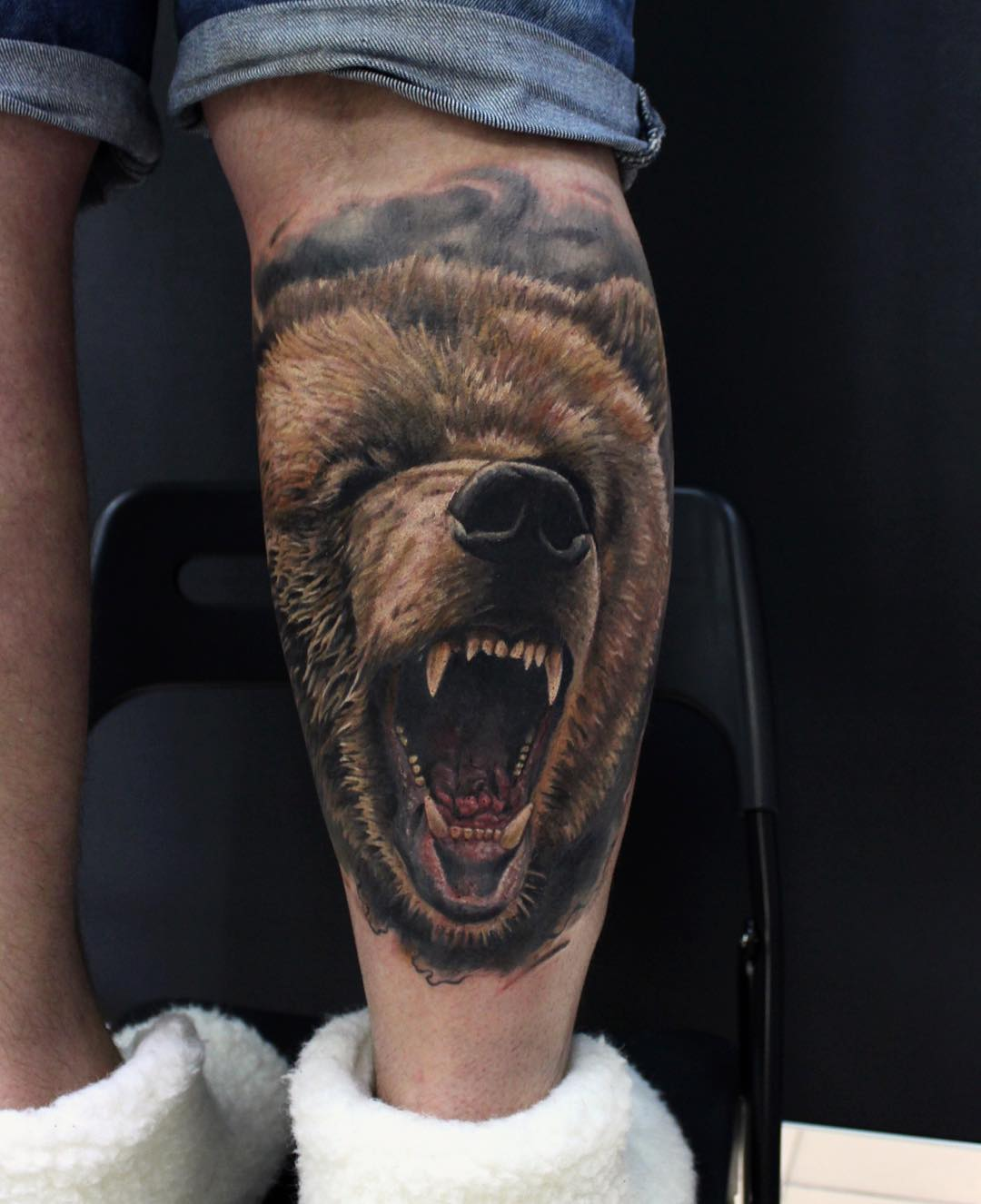 realistic tattoo of a bear on leg