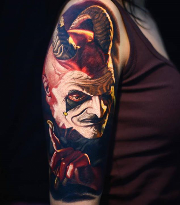 demon or satyr tattoo on shoulder