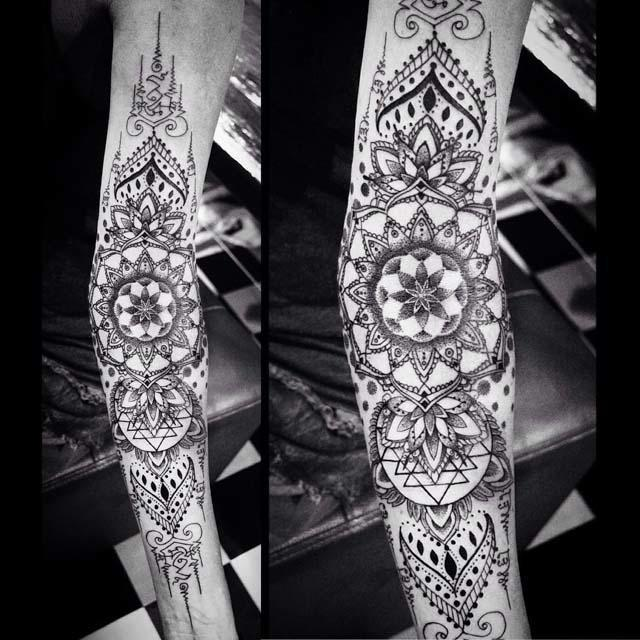 mandalas pattern tattoo on arm