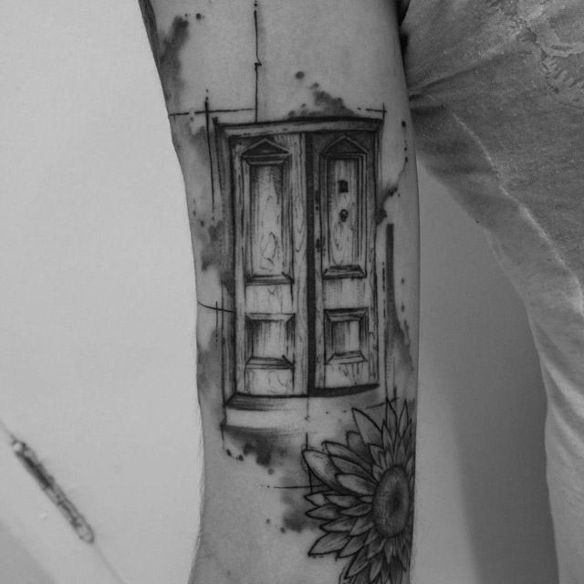 arm tattoo of a door