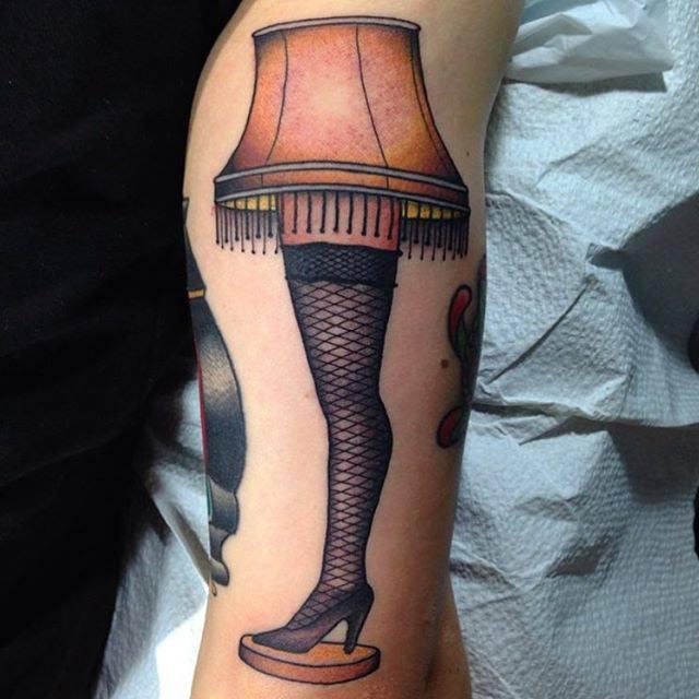 girl legs lamp tattoo