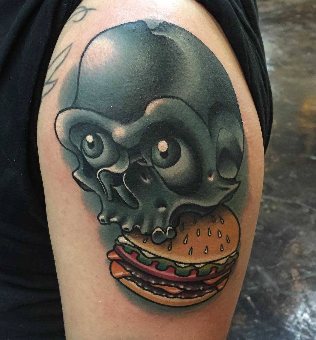 shoulder tattoo of skull and burger, new school style