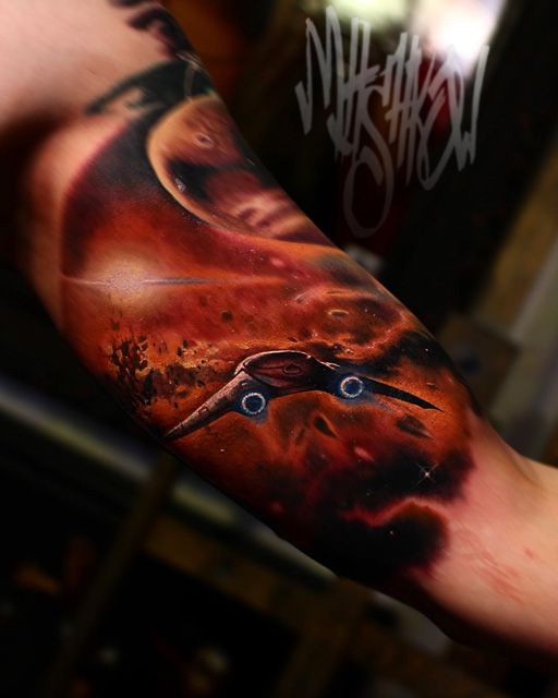 bicep tattoo of space ship